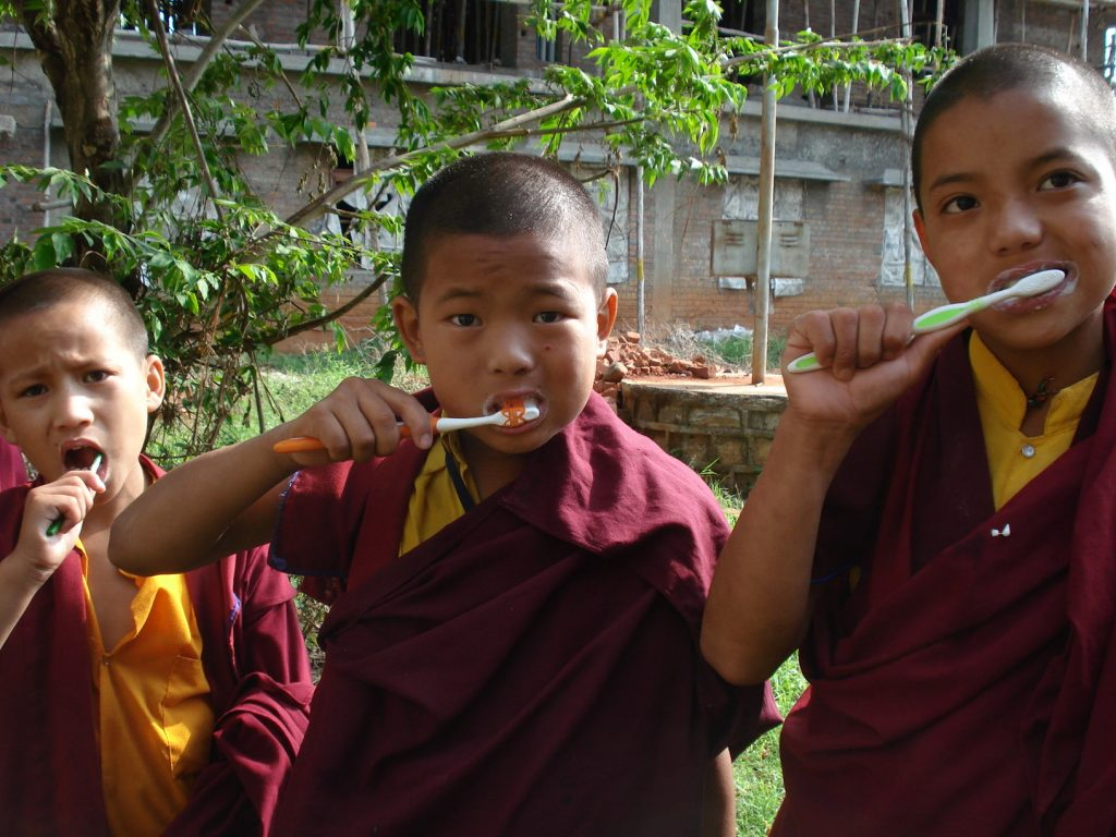 Monks brushing teeth