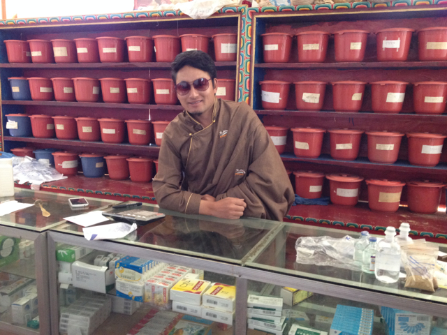 Dr. Ngawang Phuntso dispenses Tibetan and Western medicines from the clinic pharmacy.
