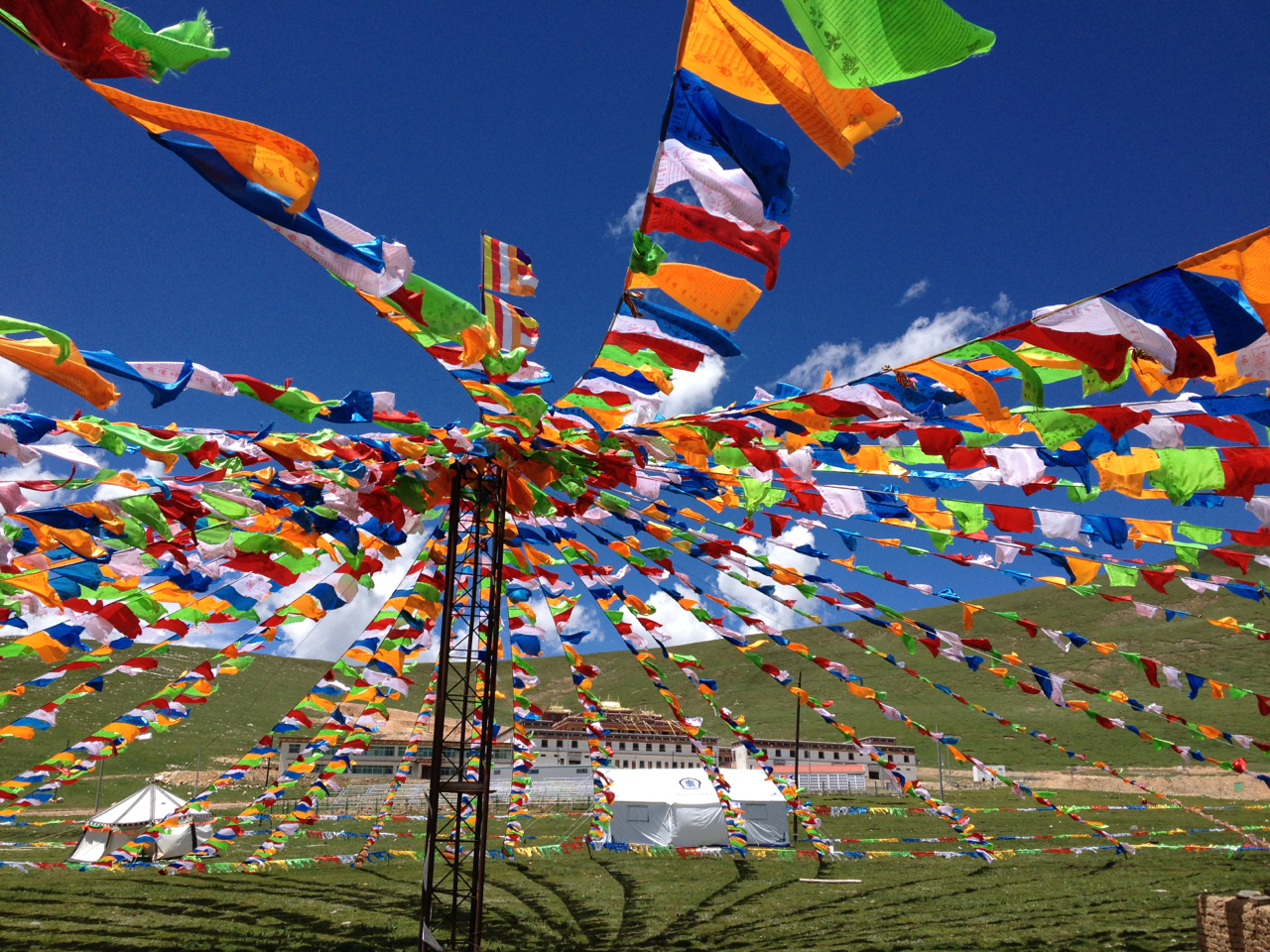 Prayer flags raised to welcome guests to Ayang Gompa, Eastern Tibet