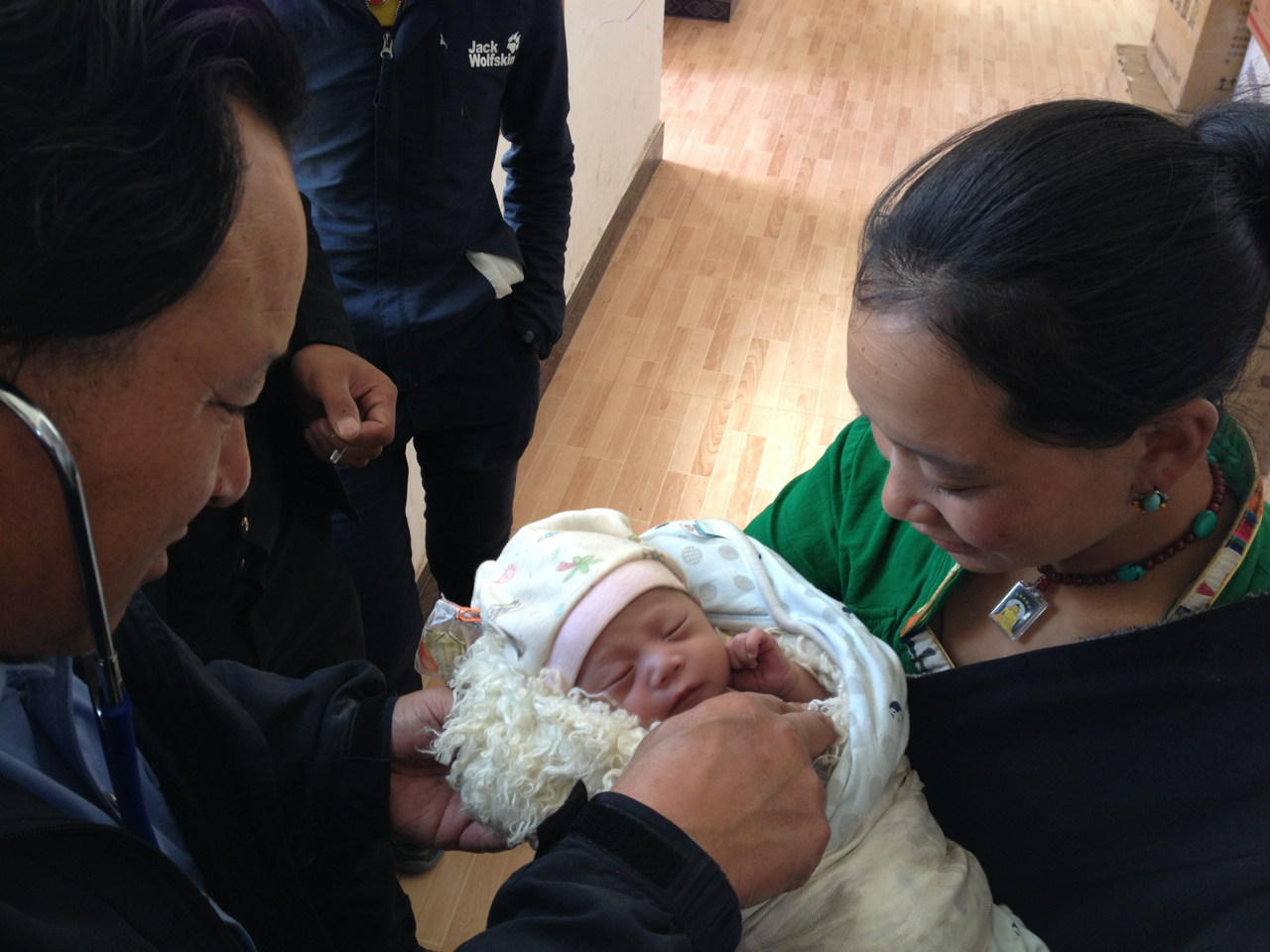 Dr. Ngagay checks newborn